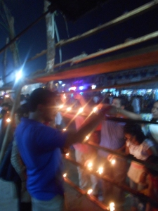People lighting the lamp