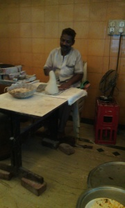 The cook with the lump of kneaded dough for Bhakri.